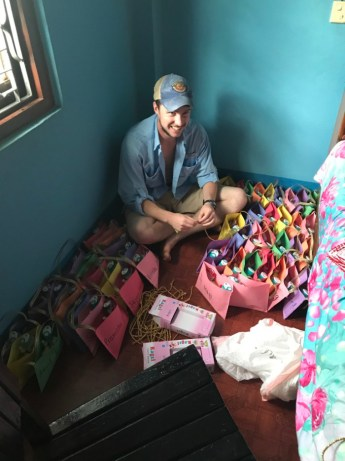 GPE volunteer, Andrew, putting together health kits for the Kindergarten children.